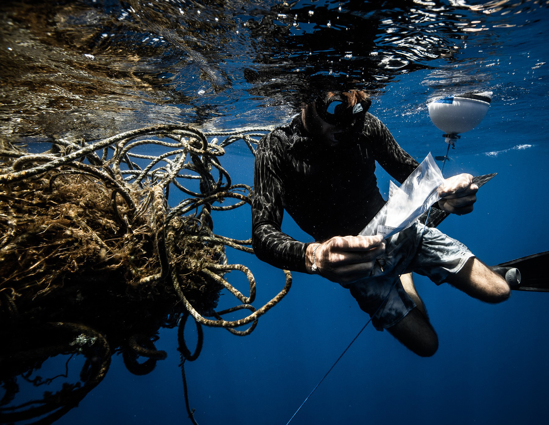 Diver under water with a lost fishing gear